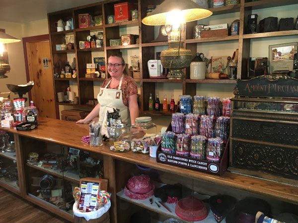 A woman behind the counter at the Township's candy store